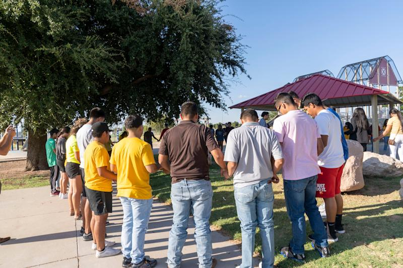 High school students from Odessa, Texas meet for a prayer vigil at Sherwood Park trying to do fun-raising for the victims of the recent shootings. The death toll rose to seven after a gunman's rampage that left many more injured following what began as a routine traffic stop in Odessa. Photo by Nick Oza/ Gannett ORG XMIT: NO 138232 Odessa shooting 9/2/2019 (Via OlyDrop)