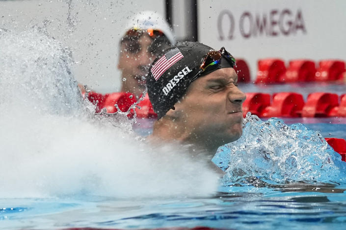 Caeleb Dressel, of United States, celebrates after winning the gold medal in the men's 50-meter freestyle final at the 2020 Summer Olympics, Sunday, Aug. 1, 2021, in Tokyo, Japan. (AP Photo/Gregory Bull)