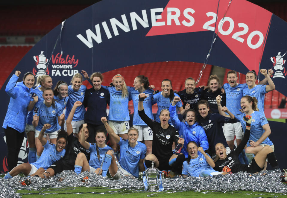 Manchester City players pose after winning the Women's FA Cup final soccer match between Everton and Manchester City at Wembley stadium in London, Sunday, Nov. 1, 2020. (Adam Davy/Pool via AP)