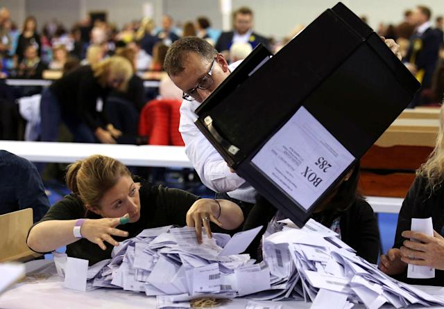 <p>Ballot boxes are emptied to be counted for the general election, at the Emirates Arena in Glasgow, Scotland, Thursday June 8, 2017. (Photo: Andrew Milligan/PA via AP) </p>