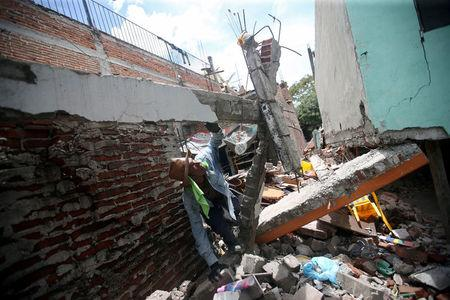 A man looks at the remains of his home after an earthquake in Jojutla de Juarez