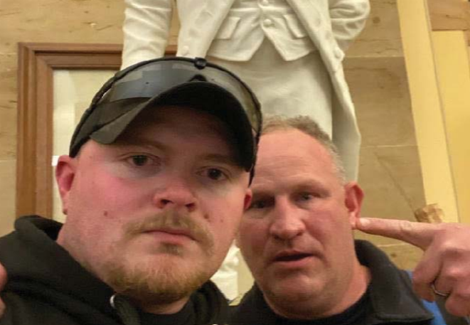 Sergeant Thomas Robertson, right, and Officer Jacob Fracker, left, posted this photograph of themselves inside the U.S. Capitol during the January 6 riots to social media. / Credit: U.S. Attorney's Office for D.C.