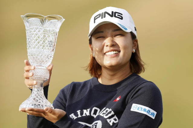 Japan's Ai Suzuki poses with trophy after winning the LPGA Japan Classic golf tournament in Otsu, Shiga prefecture, western Japan Sunday, Nov. 10, 2019. Suzuki shot a bogey-free 5-under 67 on Sunday to win the Japan Classic by three strokes for her first LPGA career victory. (Kyodo News via AP)