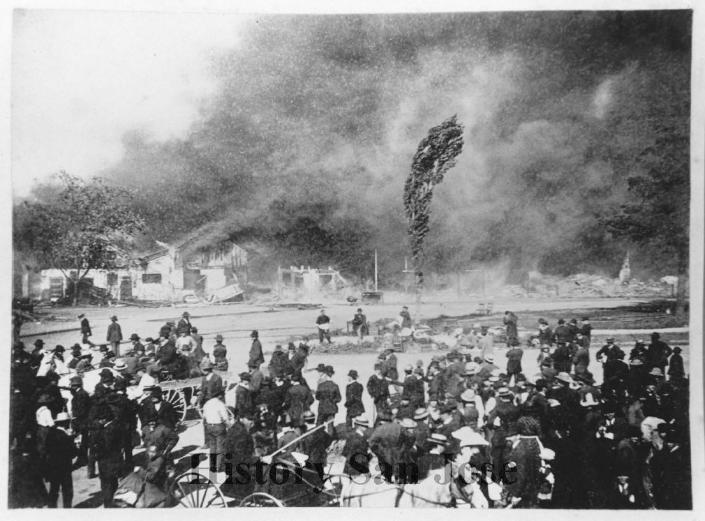 """This May 4, 1887, photo provided by History San Jose, part of the History San Jose Photographic Collection, shows a fire at Market Street in Chinatown in San Jose, Calif. The city of San Jose was once home to one of the largest Chinatowns in California. More than a century after arsonists burned it to the ground in 1887, the San Jose City Council on Tuesday, Sept. 28, 2021, unanimously approved a resolution to apologize to Chinese immigrants and their descendants for the role the city played in """"systemic and institutional racism, xenophobia, and discrimination."""" (San Jose Research Library & Archives/History San Jose via AP)"""