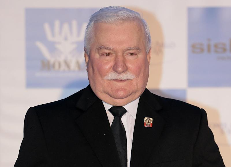 Former President of Poland Lech Walesa poses for photographers in Monaco on November 15, 2013