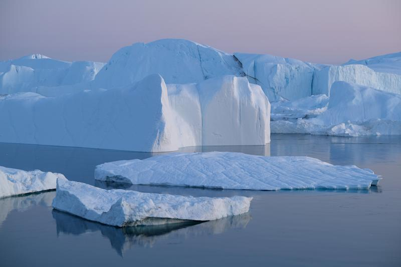 Icebergs and ice float in the Ilulissat Icefjord near Ilulissat, Greenland. (Photo: Sean Gallup/Getty Images)
