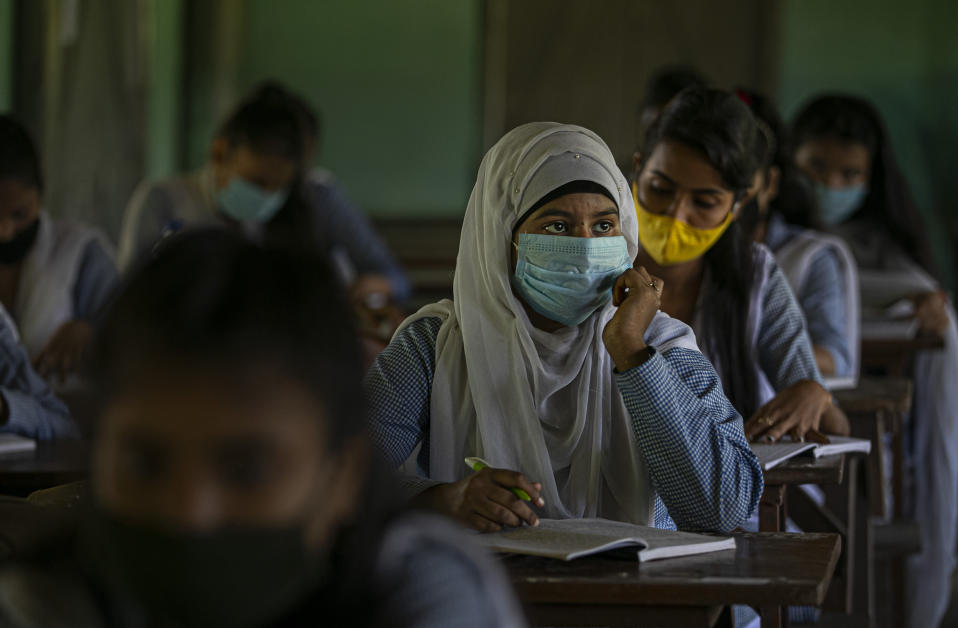 Students attend classes as schools in north-eastern Assam state reopen after being closed for months due to the coronavirus pandemic in Gauhati, India, Monday, Nov. 2, 2020. (AP Photo/Anupam Nath)