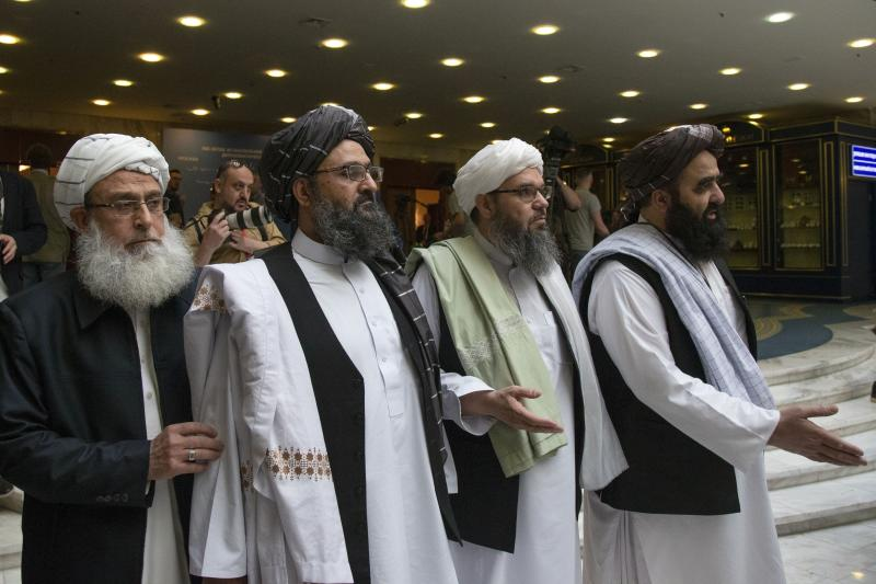"FILE - In this file photo taken on Tuesday, May 28, 2019, Mullah Abdul Ghani Baradar, the Taliban group's top political leader, second from left, arrives with other members of the Taliban delegation for talks in Moscow, Russia. The seventh and latest round of peace talks between the U.S. and Taliban is ""critical,"" said Taliban spokesman Suhail Shaheen on Sunday, June 30, 2019, the second day of talks with Washington's peace envoy Zalmay Khalilzad in the Mideastern state of Qatar, where the militant group maintains a political office. (AP Photo/Alexander Zemlianichenko, File)"
