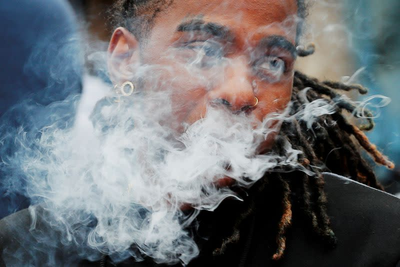 FILE PHOTO: A demonstrator vapes during a protest in Boston