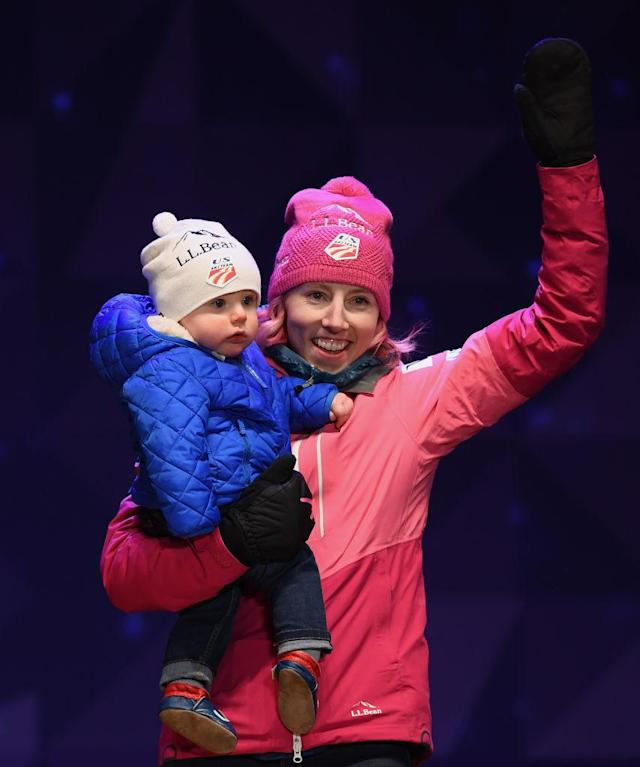Randall holds her son Breck in one arm on the podium. (Photo: Getty Images)
