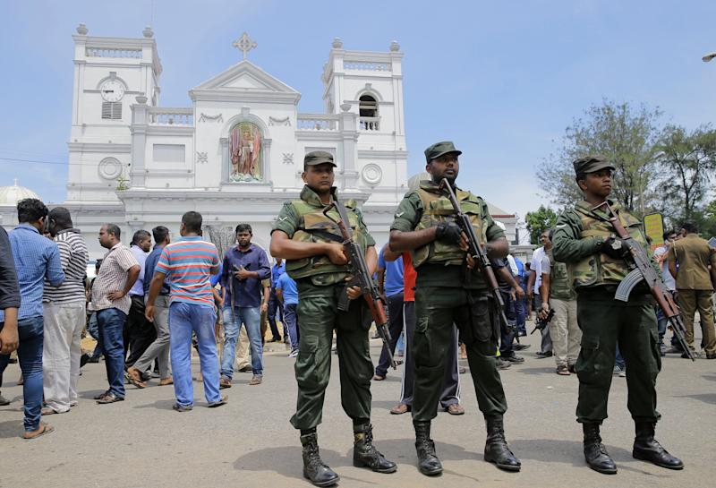 Sri Lankan Army soldiers secure the area around St Anthony's Shrine after a blast in Colombo, Sri Lanka, Sunday, April 21, 2019. A Sri Lanka hospital spokesman says several blasts on Easter Sunday have killed dozens of people. (AP Photo/Eranga Jayawardena)