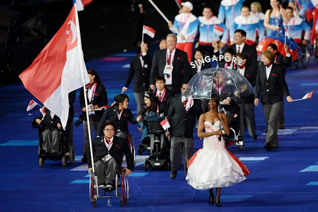 LONDON, ENGLAND - AUGUST 29: Swimmer Ruisi Theresa Goh of Singapore carries the flag during the Opening Ceremony of the London 2012 Paralympics at the Olympic Stadium on August 29, 2012 in London, England. (Photo by Gareth Copley/Getty Images)