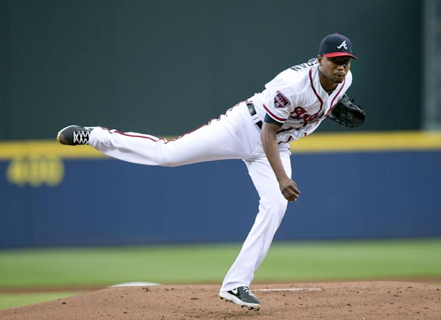 Atlanta Braves starting pitcher Julio Teheran (49) works against the Los Angeles Dodgers in the first inning of a baseball game Monday, Aug. 11, 2014, in Atlanta. (AP Photo/John Bazemore)