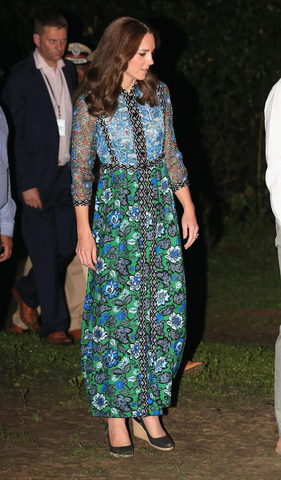 <p>A lightweight floral gown by Anna Sui was Kate's outfit of choice for a festival celebration in India. She paired the dress with the same black Dune wedges worn throughout the royal tour. </p><p><i>[Photo: PA]</i></p>