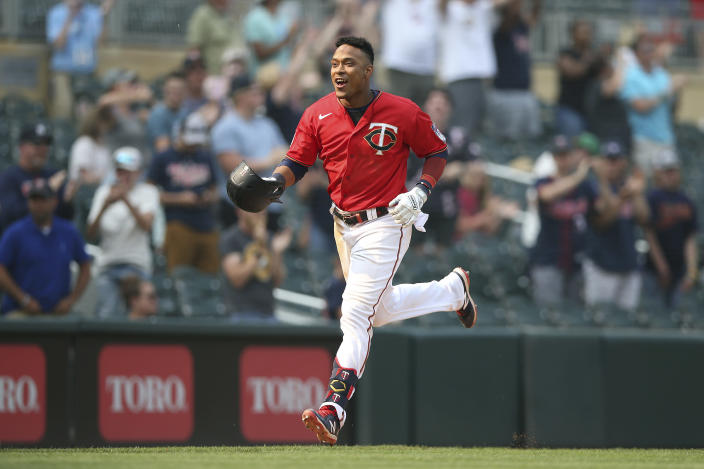 Minnesota Twins' Jorge Polanco runs to home base after hitting a homer to win the game against the Detroit Tigers during the 10th inning of a baseball game Sunday, July 11, 2021, in Minneapolis. (AP Photo/Stacy Bengs)
