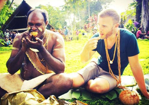 "Celebrity photos: Gary Barlow has been traveling the world in the run up to the Queen's Jubilee this summer. His latest stop has been the Solomon Islands, where he tweeted this picture. It was accompanied by the caption: ""Having some tea in Solomon islands #diamondjubilee."""