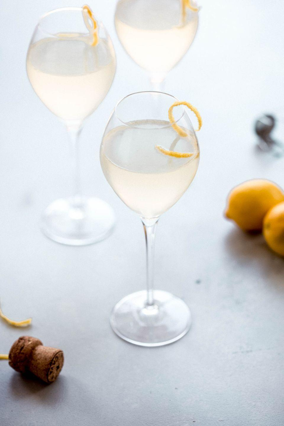 """<p>Get ready to pop some bottles: This fizzy drink feels fancy (just consider the name: French 75), but it's surprisingly simple to make. All you need is gin, simple syrup, freshly-squeezed lemon juice, and, yes, some bubbly.</p><p><a class=""""link rapid-noclick-resp"""" href=""""https://www.platingsandpairings.com/french-75-champagne-cocktail-2/"""" rel=""""nofollow noopener"""" target=""""_blank"""" data-ylk=""""slk:GET THE RECIPE"""">GET THE RECIPE</a></p>"""
