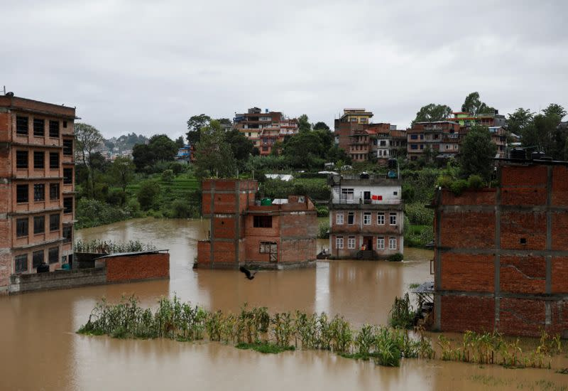 Houses are seen submerged in the waters as a river overflows due to incessant rainfall in Bhaktapur