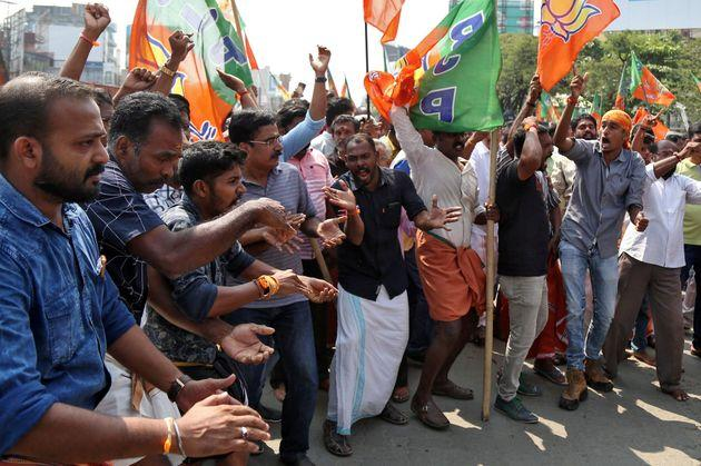 Supporters of BJP shout slogans as they block a highway during a protest against the arrest of their leader K Surendran, who police said was taken into preventive custody on Saturday night at Nilakkal base camp near the Sabarimala temple, on November 18, 2018.