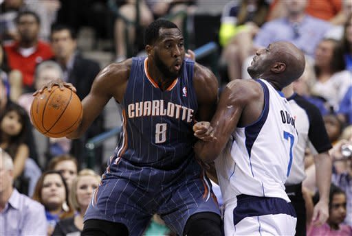 Charlotte Bobcats forward D.J. White (8) looks for an opening against Dallas Mavericks' Lamar Odom (7) in the first half of an NBA basketball game on Thursday, March 15, 2012, in Dallas. (AP Photo/Tony Gutierrez)