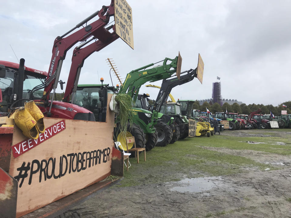 Tractors are lined up during a protest in The Hague, Netherlands, Tuesday, Oct. 1, 2019, as thousands of Dutch farmers headed to The Hague on Tuesday, many driving in slow-moving convoys of tractors that snarled traffic in the morning rush hour, for a national day of protest to demand more respect for their profession. (AP Photo/Mike Corder)