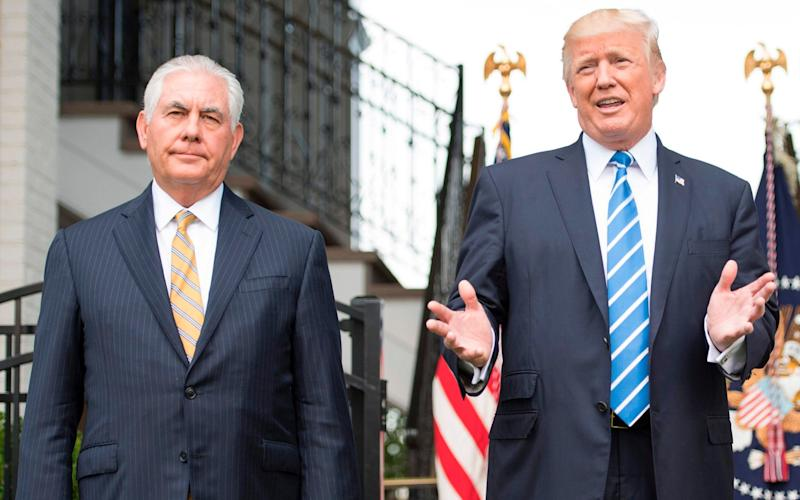 US President Donald Trump (R) speaks to the press with US Secretary of State Rex Tillerson (L) on August 11, 2017, at Trump National Golf Club in Bedminster, New Jersey - AFP
