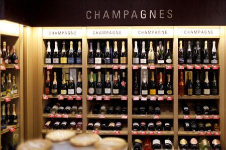 Bottles of champagne are displayed at a Nicolas French wine specialist store in Paris