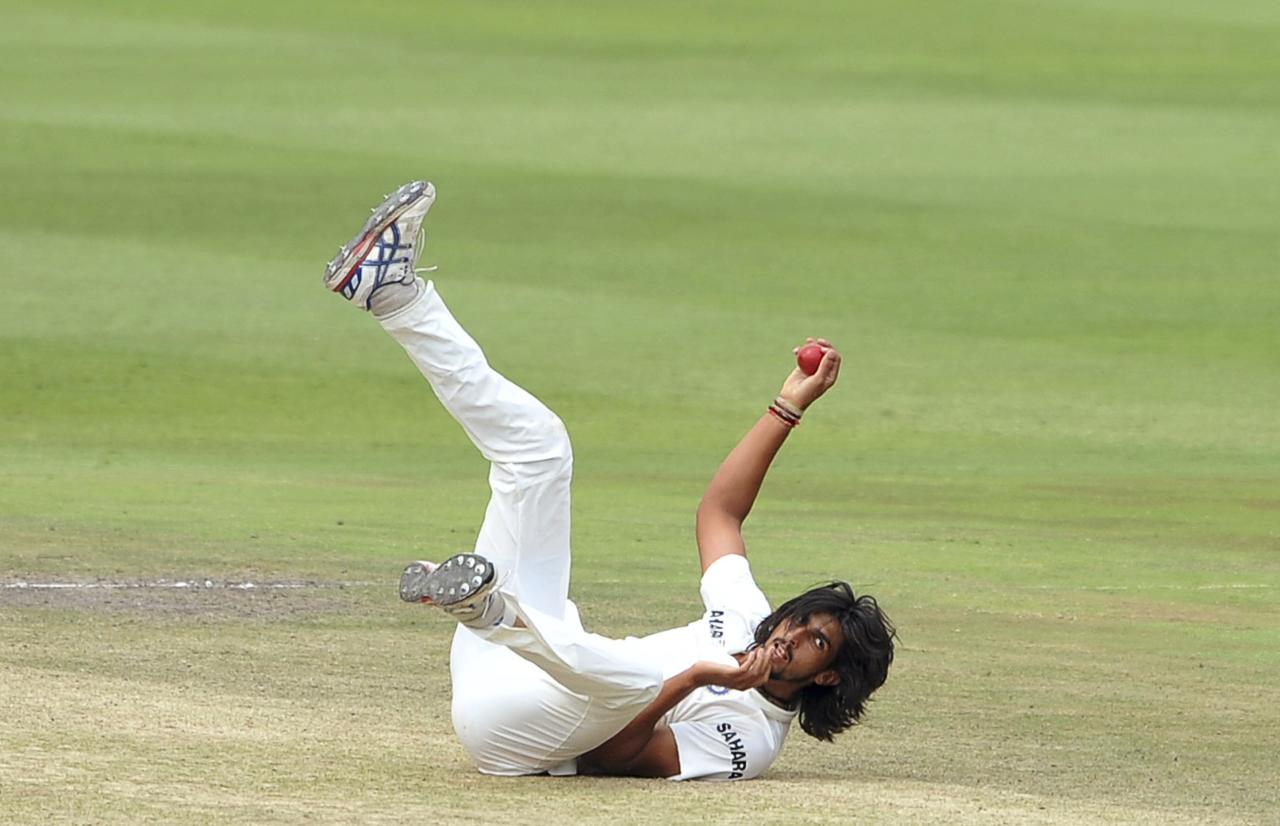 India's Ishant Sharma falls over as he tries to field the ball during the final day of their test cricket match against South Africa in Johannesburg, December 22, 2013. REUTERS/Ihsaan Haffejee (SOUTH AFRICA - Tags: SPORT CRICKET)