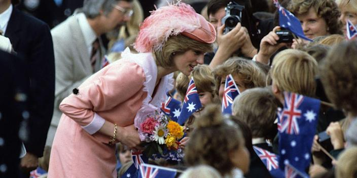 <p>Diana sports a baby pink number with a matching feathered hat in Canberra, Australia.</p>
