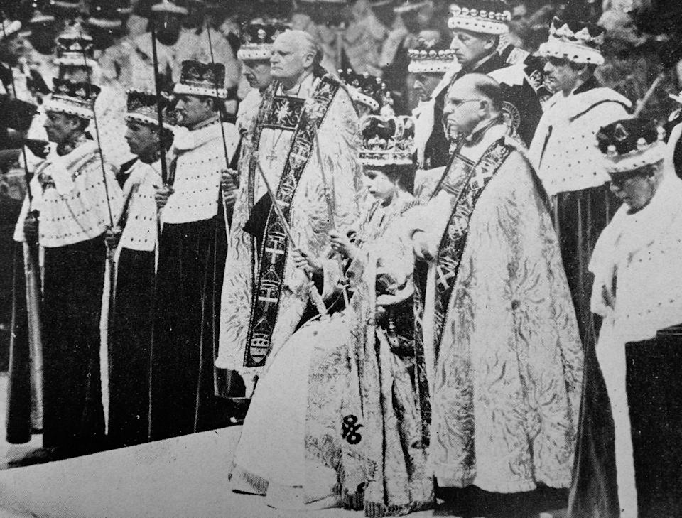 H.M. the Queen wearing St. Edward's Crown and holding the Royal Sceptre and the Rod of Equity, waits to receive the homage of her peers after her Coronation. (Photo by: Universal History Archive/Universal Images Group via Getty Images)