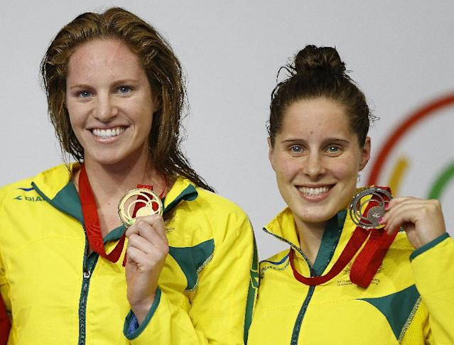 Emily Seebohm of Australia , left, gold medal and Belinda Hocking, bronze medal, pose after the 100m backstroke swimming competition at the Tollcross International Swimming Centre during the Commonwealth Games 2014 in Glasgow, Scotland, Saturday July 26, 2014. (AP Photo/Kirsty Wigglesworth)