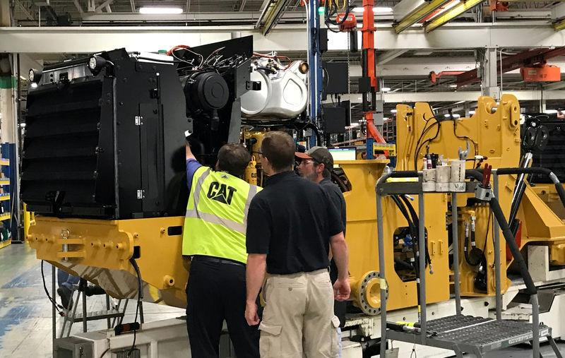 Employees work at Caterpillar's small wheel loader assembly plant is pictured in Clayton