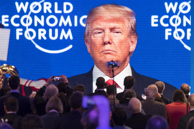 Participants watch the appearance of U.S. President Donald Trump on screen from an adjacent room, during the annual meeting of the World Economic Forum, WEF, in Davos, Switzerland, Friday, Jan. 26, 2018. (Gian Ehrenzeller/Keystone via AP)