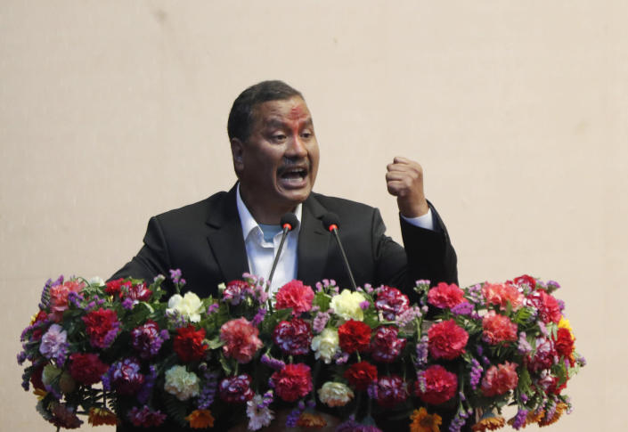 Leader of Nepal Communist Party group Netra Bikram Chand speaks during a signing of peace agreement in Kathmandu, Nepal, Friday, March 5, 2021. Chand, who is better known by his guerrilla name Biplav, emerged out of hiding on Friday after the government lifted a ban on his group so it could take part in the public signing of the peace agreement. This group had split from the Maoist Communist party, which fought government troops between 1996 and 2006, when it gave up its armed revolt, agreed to U.N.-monitored peace talks and joined mainstream politics. (AP Photo/Niranjan Shrestha)