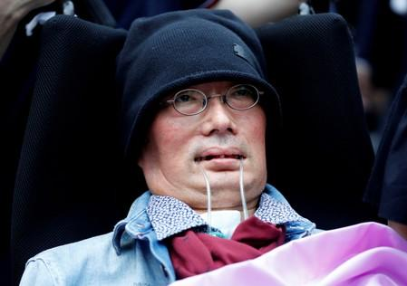 Reiwa Shinsengumi's disabled candidate for Japan's July 21 upper house election Yasuhiko Funago, who has ALS, attends an election rally in Tokyo