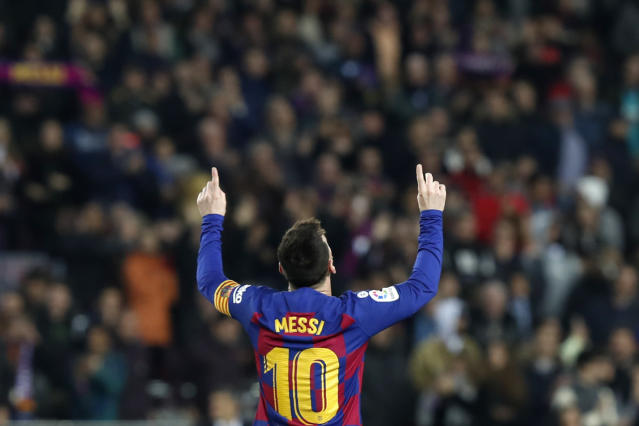 Barcelona's Lionel Messi celebrates after scoring his side's second goal during a Spanish La Liga soccer match between Barcelona and Mallorca at Camp Nou stadium in Barcelona, Spain, Saturday, Dec. 7, 2019. (AP Photo/Joan Monfort)