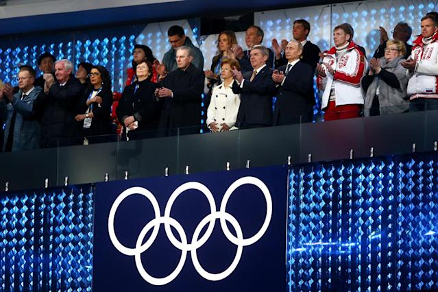 SOCHI, RUSSIA - FEBRUARY 23: (L-R) Former President of the International Olympic Committee (IOC) Jacques Rogge, Claudia Bach, International Olympic Committee (IOC) President Thomas Bach and President of Russia Vladimir Putin and Bobsleigh pilot Alexander Zubkov of Russia look on during the 2014 Sochi Winter Olympics Closing Ceremony at Fisht Olympic Stadium on February 23, 2014 in Sochi, Russia. (Photo by Paul Gilham/Getty Images)