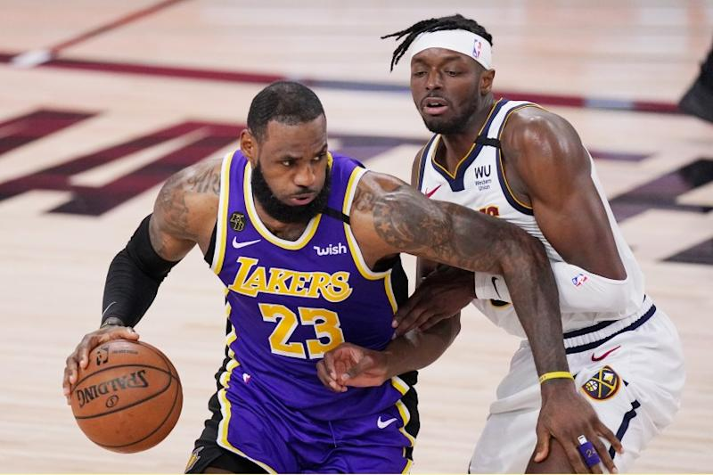 Los Angeles Lakers' LeBron James (23) drives against Denver Nuggets' Jerami Grant.