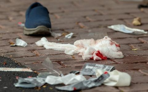 Bloodied bandages on the road following a shooting at the Al Noor mosque in Christchurch - Credit: REUTERS