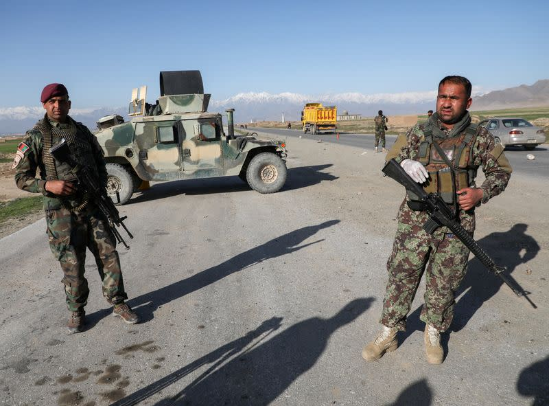 FILE PHOTO: Afghan National Army (ANA) soldiers stand guard at a check point near the Bagram Airbase north of Kabul, Afghanistan