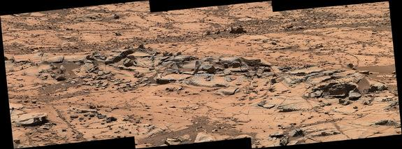 A small ridge on Mars, about 3 feet (1 meter) in length, appears to resist wind erosion more than the flatter plates around it. Curiosity rover's Mast Camera (Mastcam) obtained the exposures in this mosaic on Oct. 7, 2014.