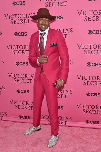 <p>Nick Cannon showed his support for the models by wearing a hot pink suit with a burgundy hat and sparkly loafers. </p>