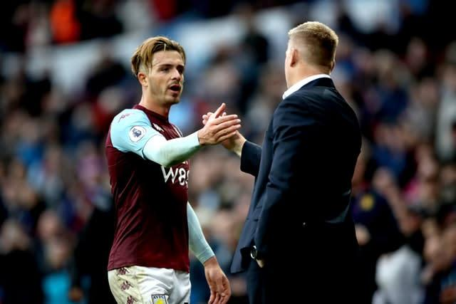 Jack Grealish, left, caught the eye of his manager Dean Smith, right (Nick Potts/PA).