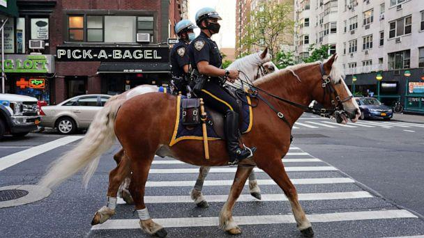 PHOTO: NYPD Mounted Unit officers ride up to Lenox Hill Hospital to show gratitude to the medical staff during the coronavirus pandemic on May 15, 2020 in New York City. (Cindy Ord/Getty Images)