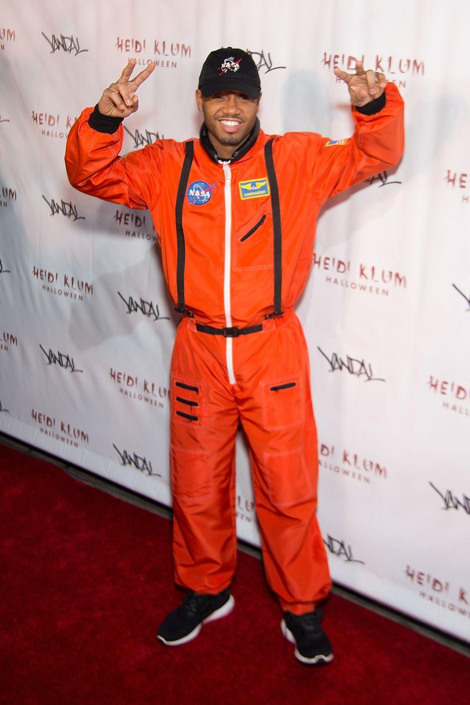 """<p>All you need is an orange jumpsuit and a NASA hat to put together an out-of-this-world astronaut costume. </p><p><a class=""""link rapid-noclick-resp"""" href=""""https://www.amazon.com/CQR-Utility-Coverall-Sleeve-Durable/dp/B083DH23WS/?tag=syn-yahoo-20&ascsubtag=%5Bartid%7C10070.g.28171554%5Bsrc%7Cyahoo-us"""" rel=""""nofollow noopener"""" target=""""_blank"""" data-ylk=""""slk:SHOP ORANGE JUMPSUIT"""">SHOP ORANGE JUMPSUIT</a></p>"""