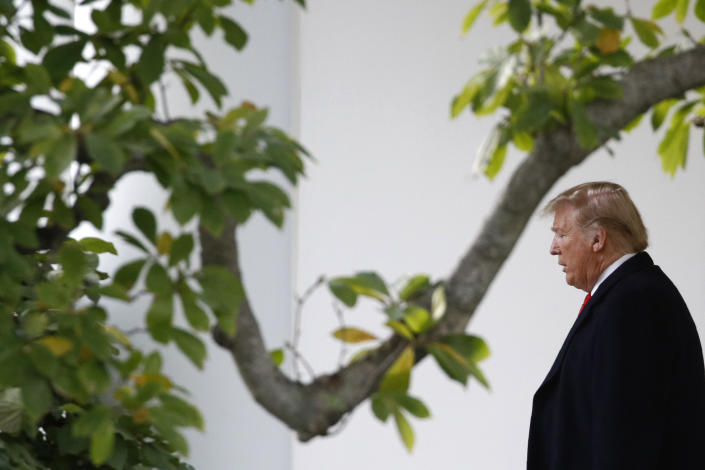 President Donald Trump walks out of the Oval Office to speak to members of the media on the South Lawn of the White House in Washington on Monday. (Photo: Patrick Semansky/AP)