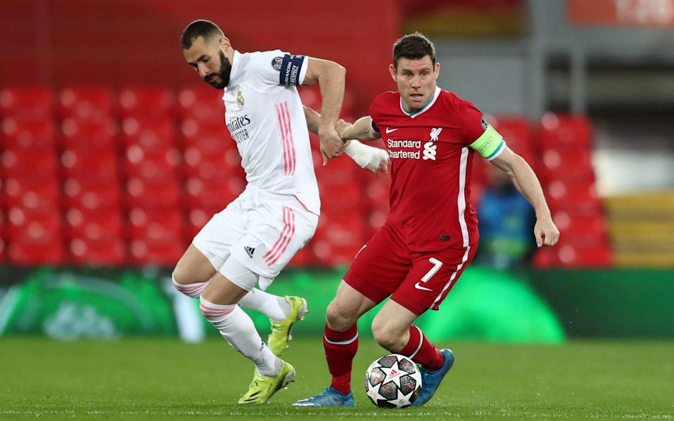 Karim Benzema of Real Madrid battles for possession with James Milner of Liverpool during the UEFA Champions League Quarter Final Second Leg match between Liverpool FC and Real Madrid - Jan Kruger - UEFA