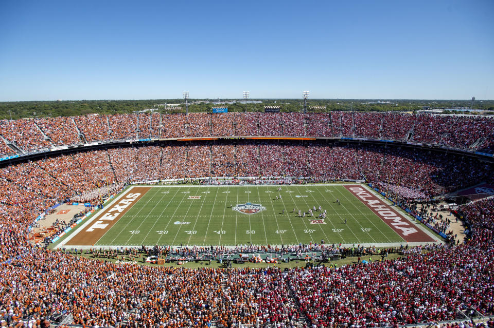 FILE - In this Oct. 12, 2019, file photo, Texas and Oklahoma fans fill the Cotton Bowl during the first half of an NCAA college football game in Dallas. College football fans will head back into stadiums this weekend. Along with binoculars, sunscreen and other essentials, some will pack facemasks and proof of vaccination. With the availability of COVID-19 vaccines, the pomp and pageantry of fall Saturdays are expected to return nearly everywhere across the country. (AP Photo/Jeffrey McWhorter, File)