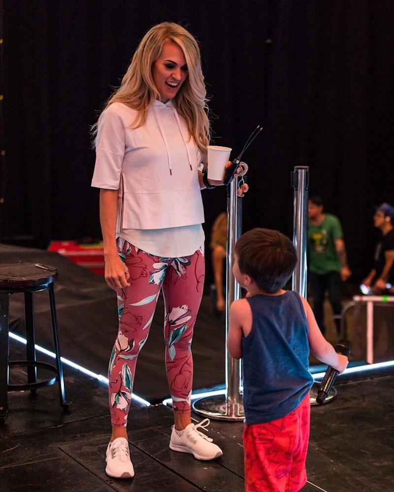 Carrie Underwood and her son on stage