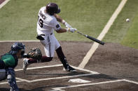 Mississippi State's Logan Tanner (19) hits a seventh inning home run against Notre Dame during an NCAA college baseball super regional game, Saturday, June 12, 2021, in Starkville, Miss. Mississippi State won 9-8. (AP Photo/Rogelio V. Solis)